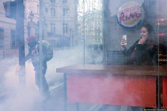 This photo from the protests in Paris so perfectly encapsulates our current world I thought it was staged.