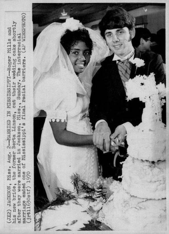 Mississippi's first interracial bride and groom enjoying their wedding cake in 1970. Their marriage was the first interracial marriage in Mississippi since the 1967 Loving v. Virginia Supreme Court ruling that legalized interracial marriage nationwide.
