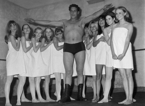 A young Andre the Giant surrounded by french models