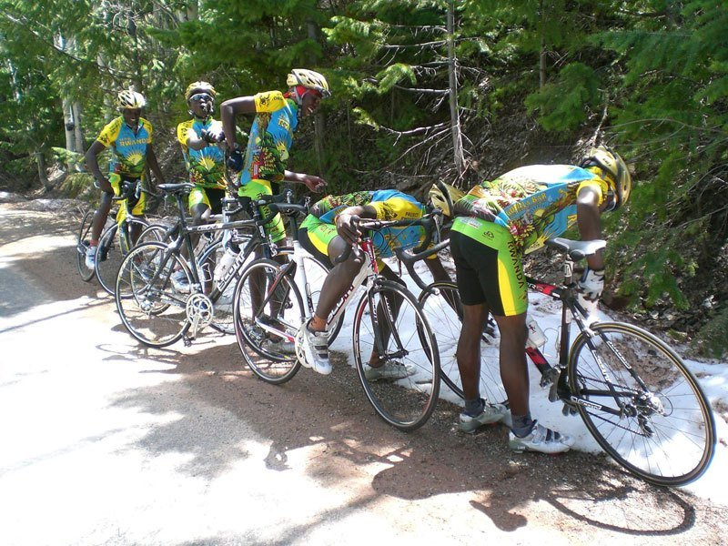 Team Rwanda Cycling stop to touch some snow as it was the team's first time ever seeing it