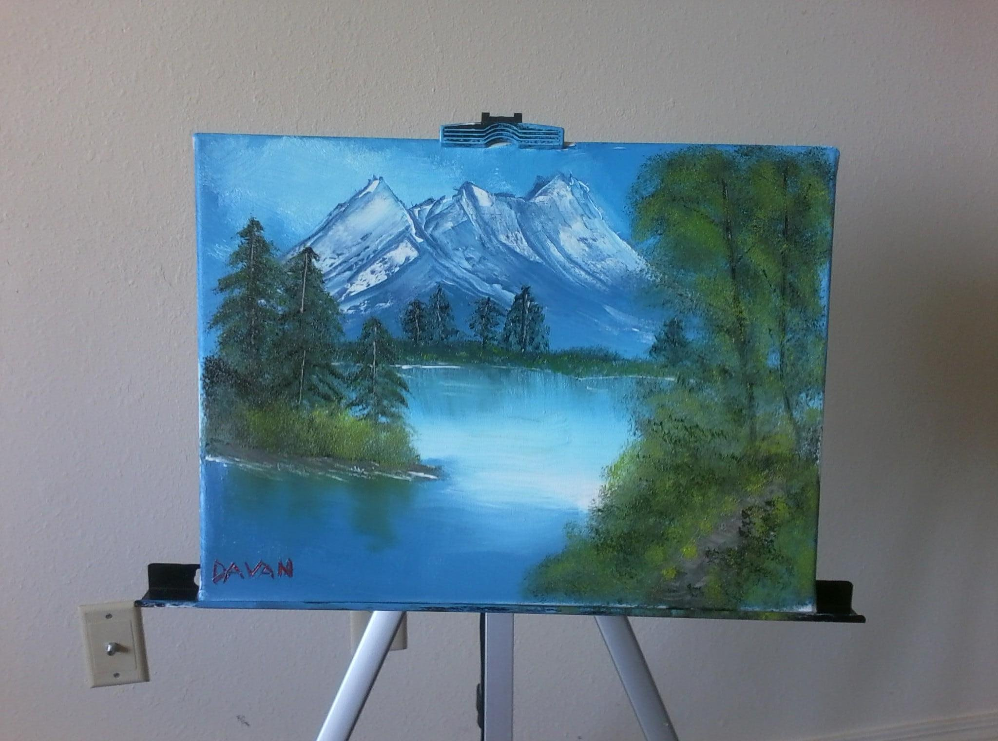 A 10 year old girl attempt at Bob Ross's The Joy of Painting. Not bad.