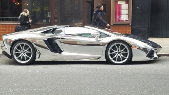 Walking down the streets of NYC when a chrome Lamborghini rolls up.