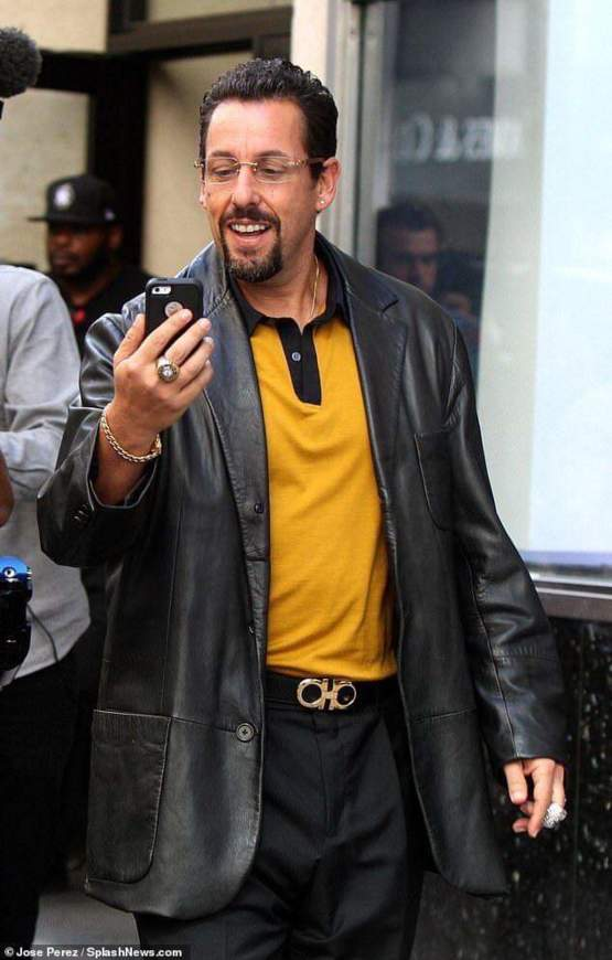 Adam Sandler looks like he owns about 4 strip clubs