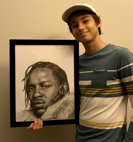 Me with my Kendrick Lamar drawing done with pencil and acrylic.