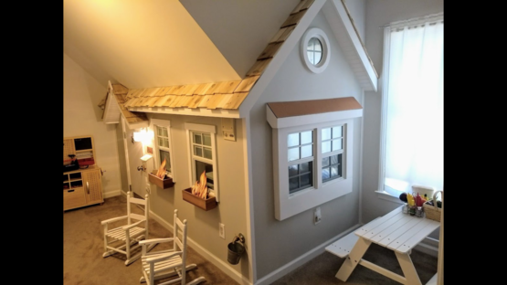 My husband built this inside playhouse for our foster children. It has a kitchen and real working windows and lights!