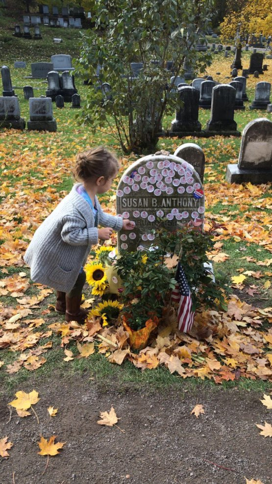 Putting her mother's sticker on Susan B. Anthony 's grave
