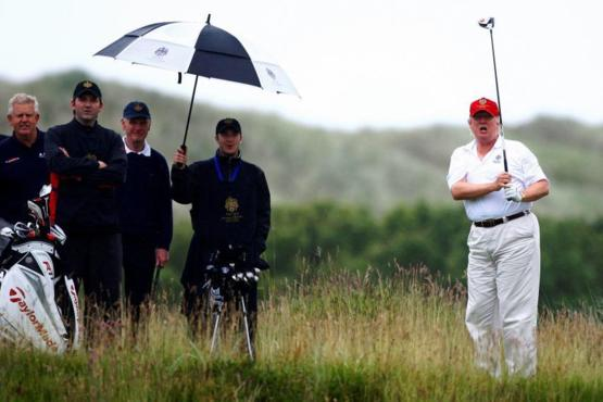 Trump plays golf in the rain but does not honor the troops in it.