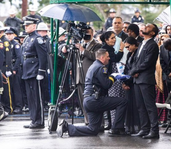 Corporal Ronil Singh's wife receiving his burial flag