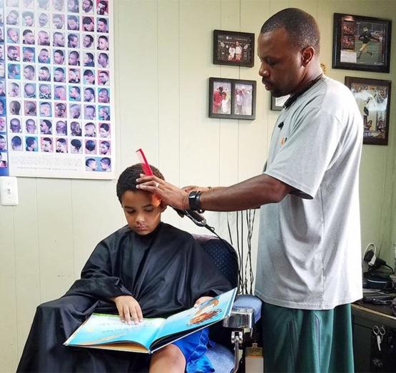 Michigan barber gives kids $2 discounts if they read a book out loud, 2016.