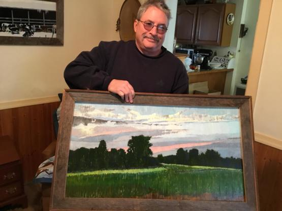 My dad has painted every single day since I was a kid. Here he is with his newest piece that he created using just vertical lines.