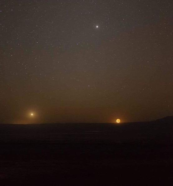 On the left side Venus, the right side the moon and above Jupiter.