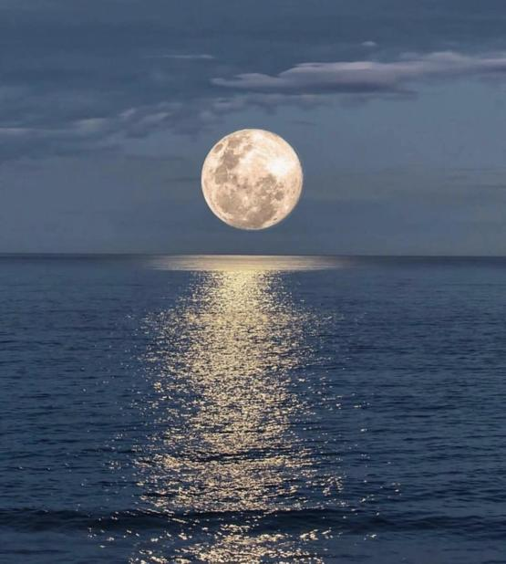 Reflection of the moon on the ocean