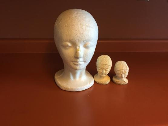 Three identical styrofoam heads. One untouched, one taken to a depth of 1000 feet, and one taken to 2000 feet.