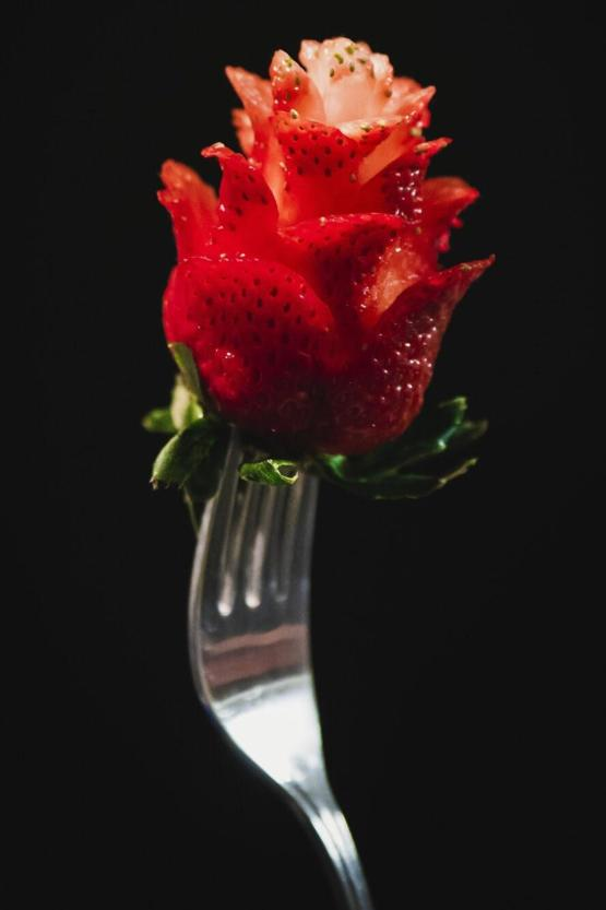 My girlfriend made a Rose out of a strawberry. I took a photo of it!