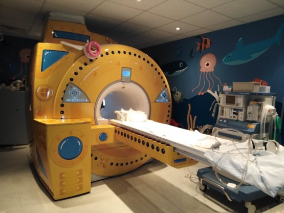 doctors paint the MRI machine in the children's clinic to look like
