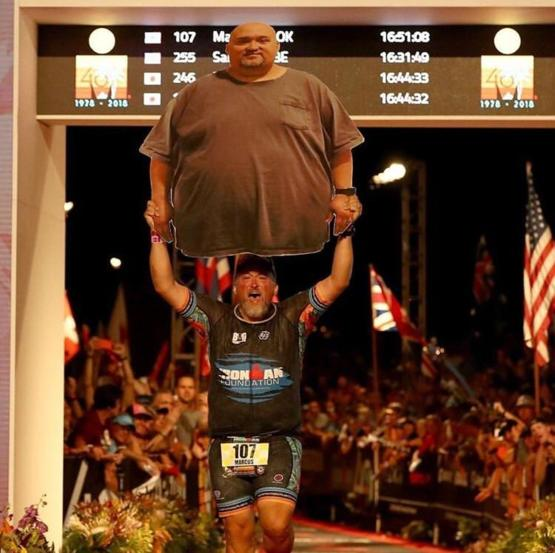 Marcus cook inspiring thousands, as he crosses the finish line of Ironman in Kona