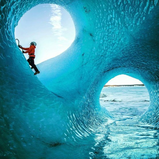 Ice cave carved out by water moving through a glacier