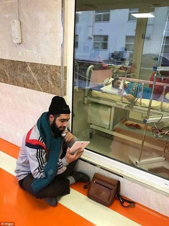 An Iranian teacher sits by his young student who has cancer, in order to catch him up on the days lessons