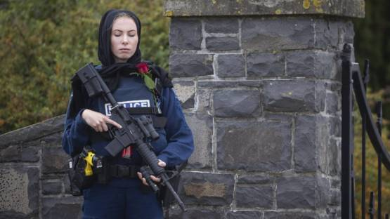 New Zealand Police Officer stands guard as Christchurch victims laid to rest