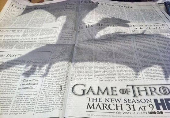 Back when HBO was promoting the 3rd season of Game of Thrones, they placed this ad in New York Times, with the shadow of a dragon looming over two pages of the newspaper.