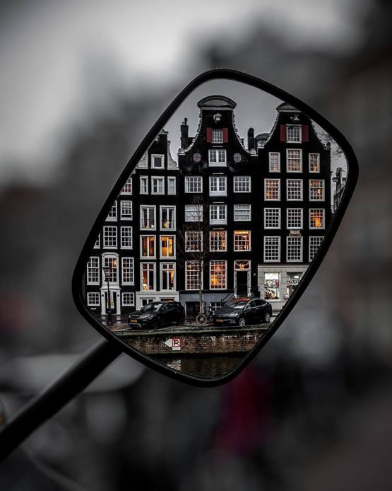 Amsterdam in a wing mirror