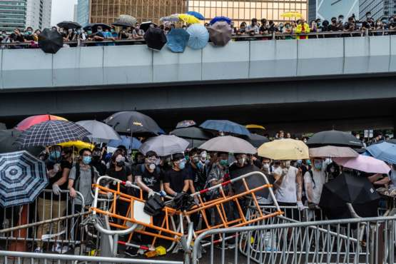 Protesters protecting themselves from Pepper Sprays and Water Cannons in Hong Kong