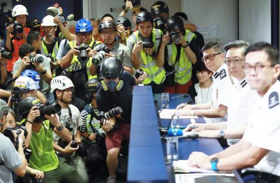 Hong Kong press wears helmets, eye masks and reflective vests to express discontent towards local police's actions.