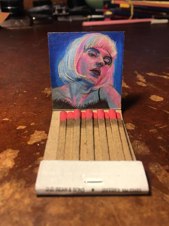 I love drawing inside matchbook covers, here is my latest portrait