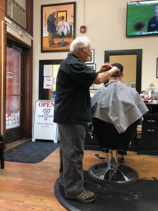 Grandpa owns a barber shop and a long-time customer painted him in action. This is me recreating the painting with him.