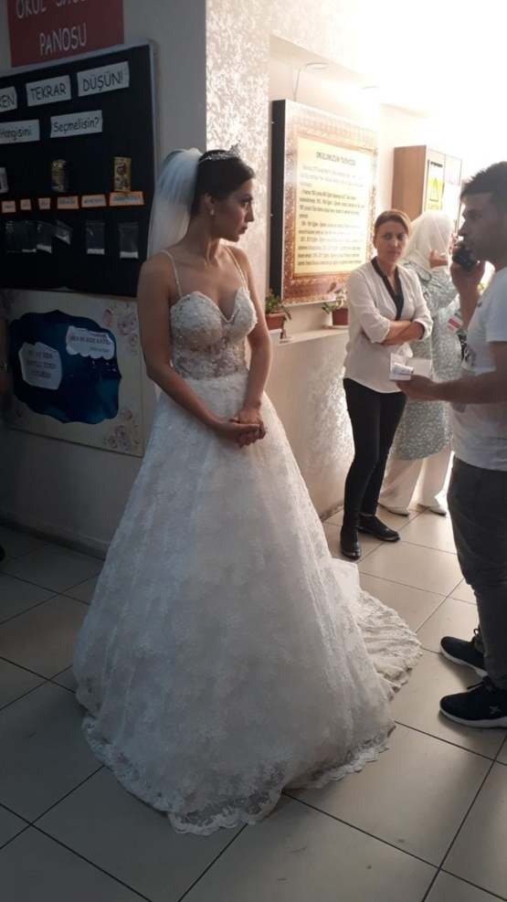 A bride waiting to vote in the Istanbul Mayoral Elections, before attending her own wedding.