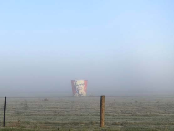 Local KFC got pulled down a few years back, owner kept the old bucket and put it on his property near the highway. Was foggy a few days ago and was able to catch this