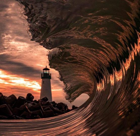 A wave at sunset