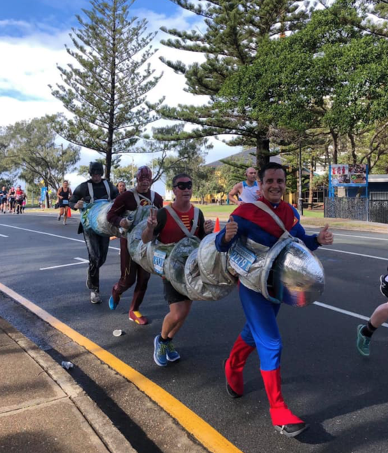 My dad and his friends broke the guinness world record for the quickest marathon in a four person costume. They raised over $6500 for the save the children charity in the process.