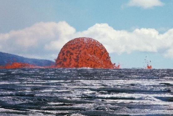 This photo captures a rare sight of a 65-foot-tall Lava Dome in Hawaii. Symmetrical dome fountains such as this are again, extremely rare and hard to come by.