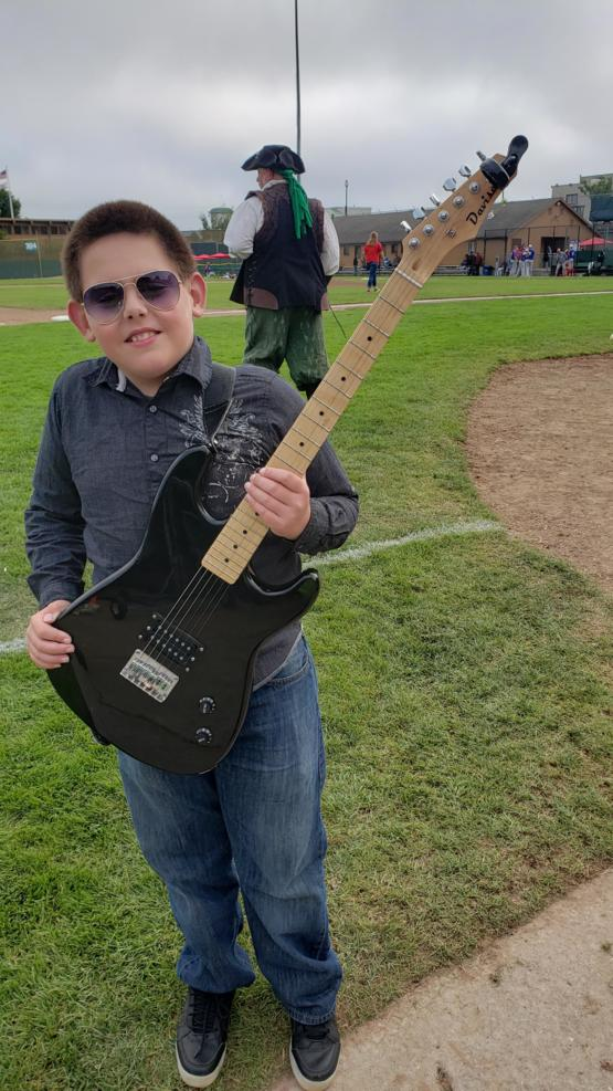 This little dude landed his first gig! Star Spangled Banner for 500 people at a local college baseball game.