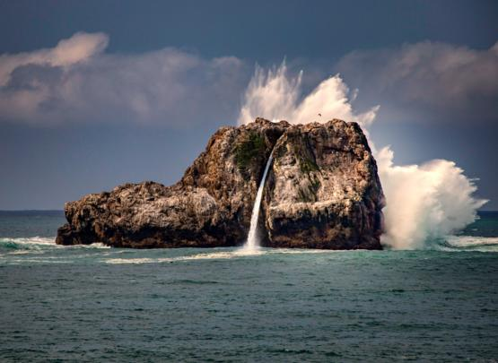 There's a rock in California that temporarily has a waterfall when the waves crash on it just right.
