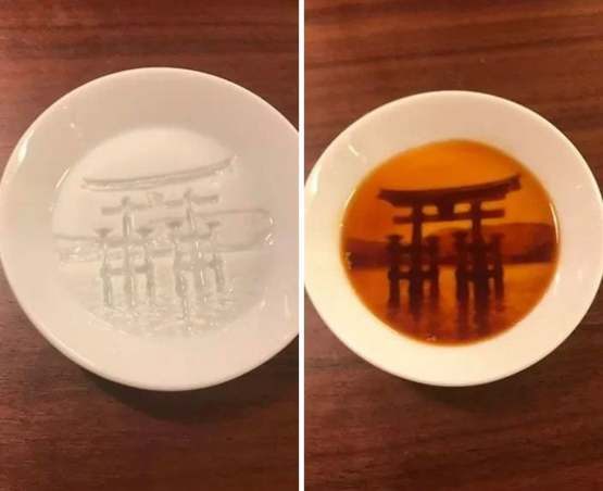 """Soy sauce dishes that """"reveal"""" a painting once you fill them up"""
