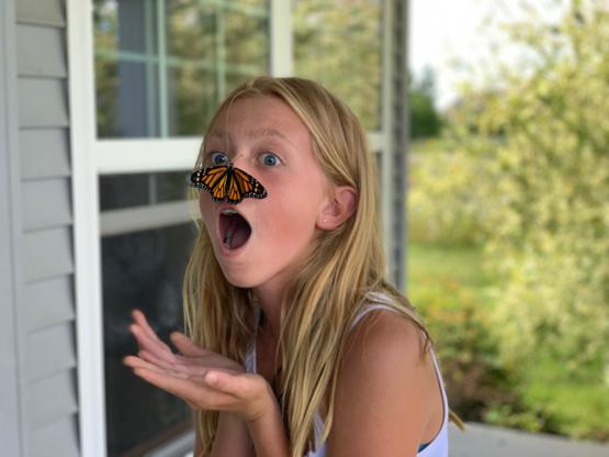 A monarch we raised and were releasing decided to land on my daughter's nose.