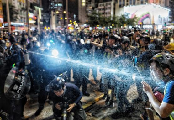 Hong Kong Police Pepper Spray Journalists That Are Recording Their Beatings
