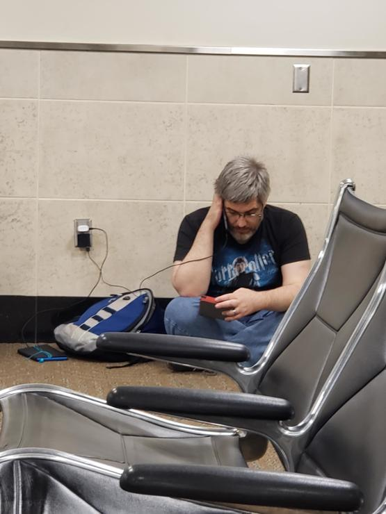 At the airport tonight and after sitting began to hear the soft sound of reading aloud (with voices!). This man is reading the Lord of the Rings to his children and it reminded me of my mom. I hope to be that kind of parent someday.