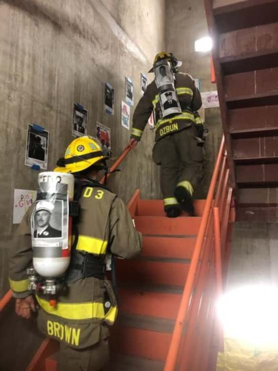 Firefighters climbing 110 stories in full gear in remembrance of the first responders who gave their lives.