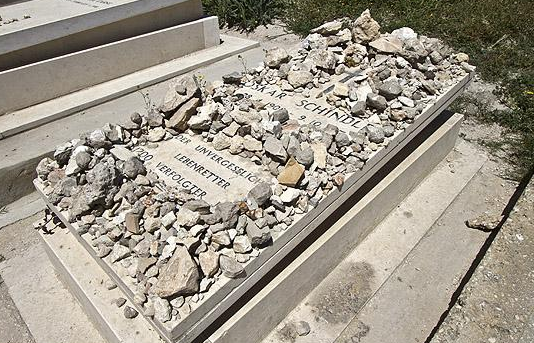 In the Jewish faith, it's customary to place a stone on the grave as a symbol of remembrance. This is the grave of Oskar Schindler, who saved roughly 1,200 Jews during the Holocaust