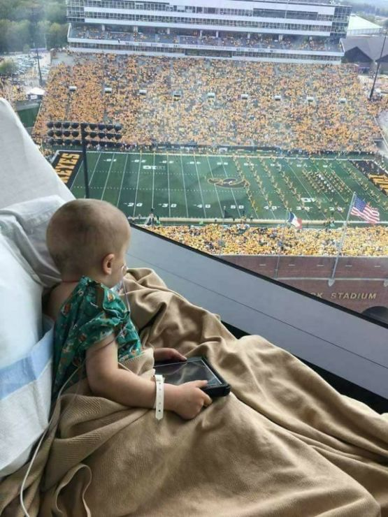 Iowa Children's Hospital, fans and players wave to the kids in hospital.