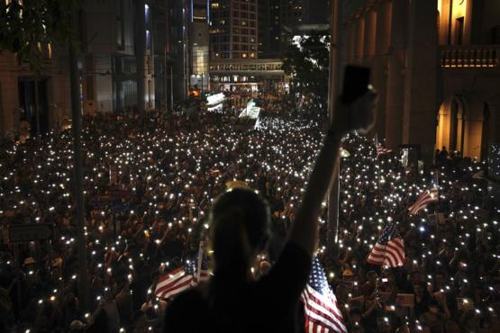 Protesters light their mobile devices during a peaceful rally in central Hong Kong's business district, on October 14, 2019.