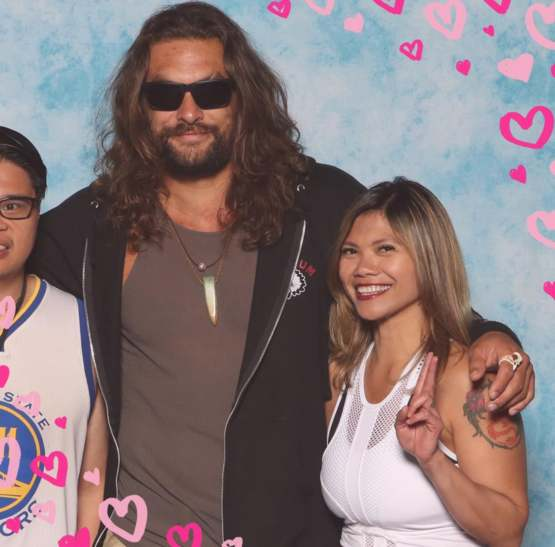 This is how my girlfriend posted our photo op with Jason Momoa