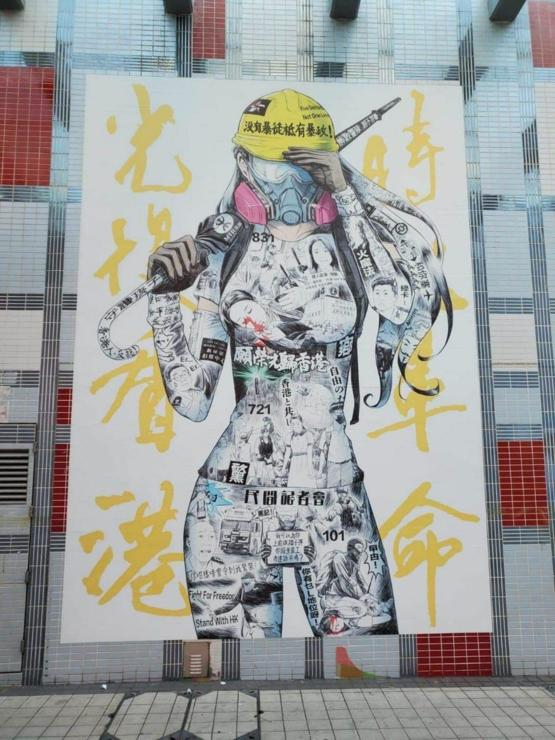 """Protest Art Spotted in Hong Kong; in the background it writes """"Liberate Hong Kong, Revolution of Our Times"""""""