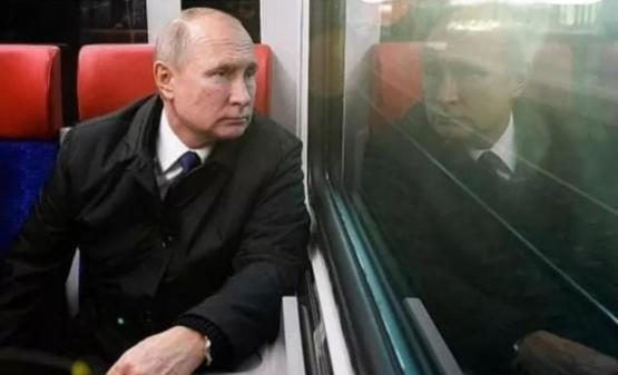 A picture of Putin looking at the next President of Russia