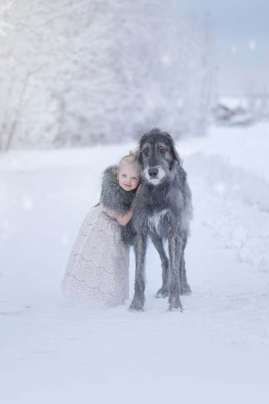 Took my dog and daughter out for the first time together, in a winter wonderland. (X-post r/aww)