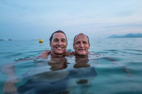 Matthew McConaughey and Woody Harrelson taking a swim.
