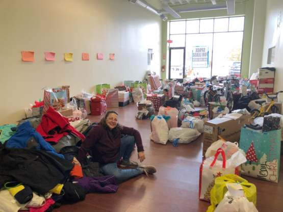 My mom organizing clothes, toys and games for 850 kids in inner-city Detroit, MI